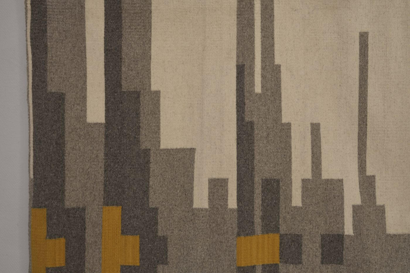 Handwoven rug, with block pattern in greys, neutrals and yellow