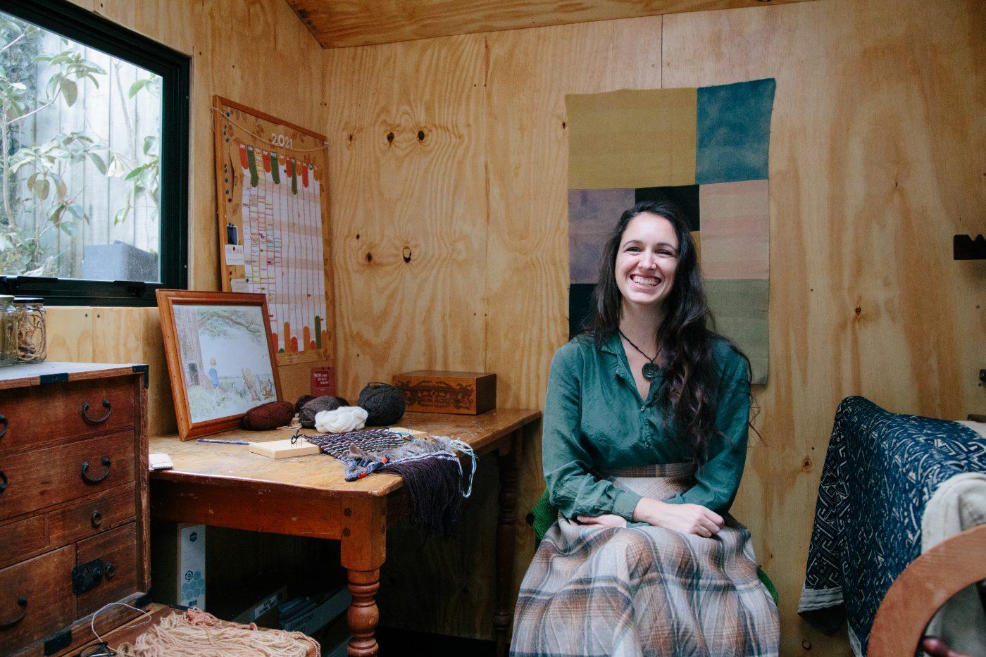 Seated female in artist workshop