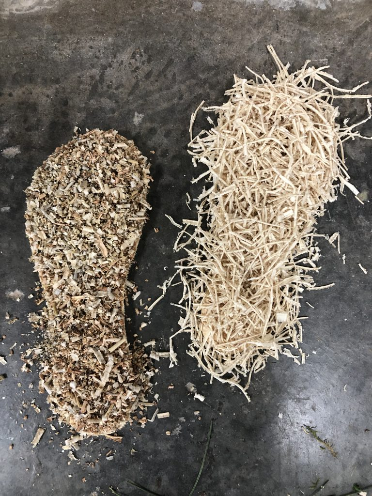 Two material experiments and combinations of wood and wood shavings, each in the shape of a shoe's sole