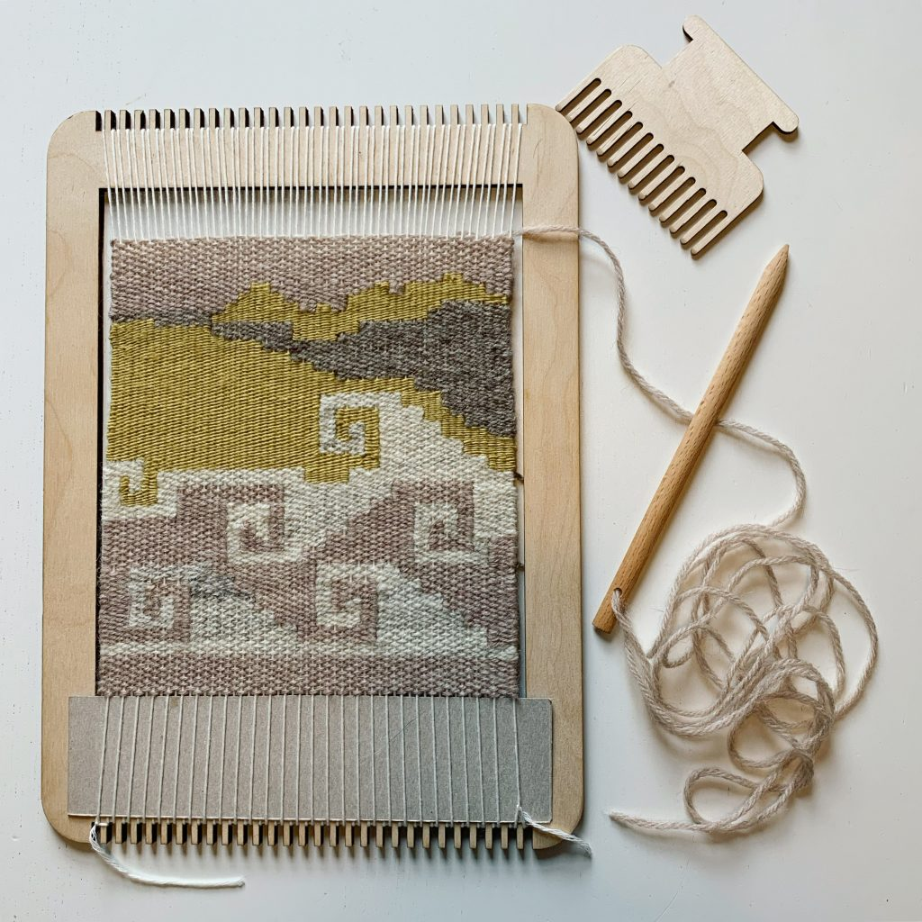 Weaving a spiral / wave pattern in yellow, cream, light and dark brown on a simple plywood, frame loom