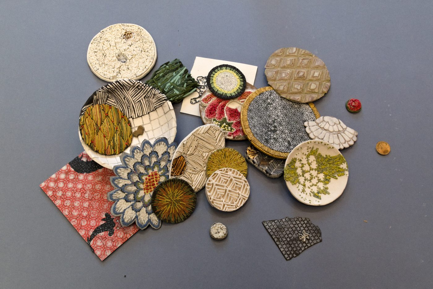 Round and shaped samples of porcelain in different colours and patterns